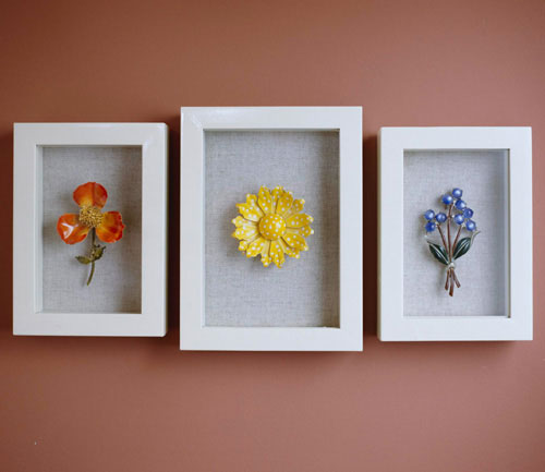 Simple, colorful vintage jewelry displayed in shadow boxes by Do It Yourself Ideas Magazine