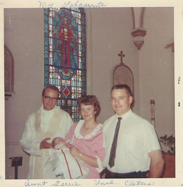 Me at my baptism with my godparents Aunt Gerrie and Uncle Cletus