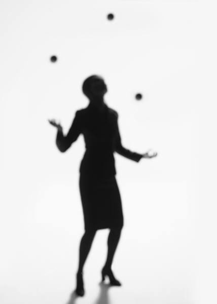 Silhouette of woman juggling