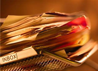 Stock photo: Inbox stuffed with paper clutter