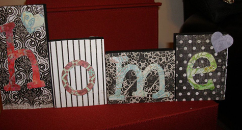 Wood blocks painted, then Mod Podged with scrapbook paper and letters
